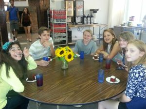 Some of the Middle Schoolers enjoying some cake the chefs made on the first day.